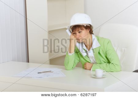 Woman - Construction Superintendent Sits Upset