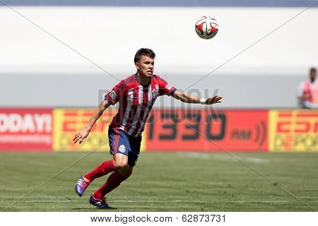 CARSON, CA - APRIL 6: Chivas USA M Carlos Alvarez (20) during the MLS game between the Los Angeles Galaxy & Chivas USA on April 6th 2014 at the StubHub Center in Carson, Ca.
