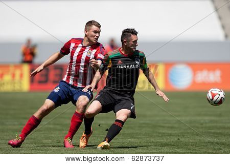 CARSON, CA - APRIL 6: Chivas USA D Eriq Zavaleta (22) & Los Angeles Galaxy F Robbie Keane (7) during the MLS game between the Los Angeles Galaxy & Chivas USA on April 6th 2014 at the StubHub Center.