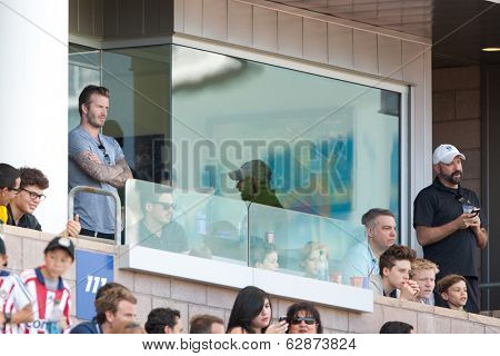 CARSON, CA - APRIL 6: David Beckham (L) and his kids (R) watch the MLS game between the Los Angeles Galaxy & Chivas USA on April 6th 2014 at the StubHub Center in Carson, Ca.