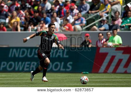 CARSON, CA - APRIL 6: Los Angeles Galaxy M Stefan Ishizaki (24) during the MLS game between the Los Angeles Galaxy & Chivas USA on April 6th 2014 at the StubHub Center.