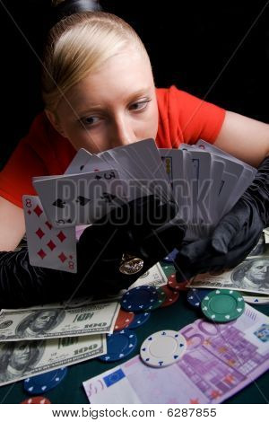Young Smiling Woman On The Poker Table