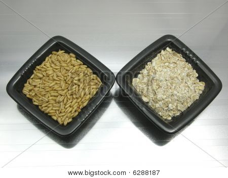 Bowls Of Chinaware With Oat And Porridge On Reflecting Matting