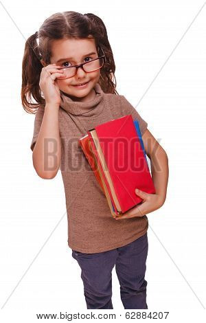 baby girl brunette glasses reads the book keeps smiling isolated