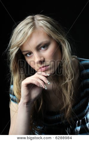 Sad Teenage Woman On Black