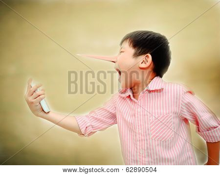 Long Nose Angry Asian Child Shouting At Mobile Phone,liar Concept
