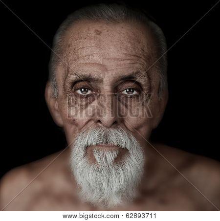 Very Striking image of a latino Man Looking at you.