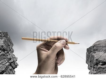 Close up of human hand holding pencil