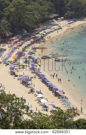 Phuket, Thailand-february 20Th 2014: Tourists At Laem Singh Beach On Phuket. The Beach Is A Favourit
