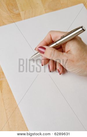 Womans Hand With Pen
