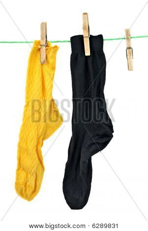 Yellow And Black Socks Hanging On Rope