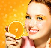 image of freckle face  - Beauty Model Girl takes Juicy Oranges - JPG