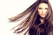 image of hair blowing  - Fashion Model Girl Portrait with Long Blowing Hair - JPG