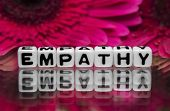 stock photo of empathy  - Empathy text message with pink flowers in the background - JPG