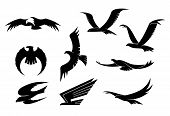 stock photo of eagles  - Silhouette set of flying eagles - JPG