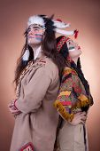 Native American Couple On Brown Background