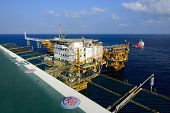 foto of big-rig  - The big offshore oil rig platform and supply boat