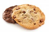 stock photo of white sugar  - Large light chocolate chip cookie on a white surface - JPG
