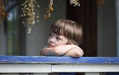 pic of little boys only  - sad little boy on the porch of rural house - JPG