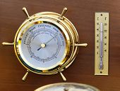 stock photo of barometer  - Retro style brass barometer and thermomether weather station - JPG