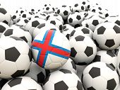 foto of faroe islands  - Football with flag of faroe islands in front of regular balls - JPG