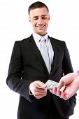 picture of pervert  - Businessman giving money isolated on white background - JPG