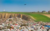 stock photo of landfills  - Pile of diverse domestic garbage in landfill - JPG
