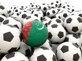 stock photo of turkmenistan  - Football with flag of turkmenistan in front of regular balls - JPG