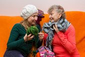 pic of knitted cap  - A mother and his daughter are knitting together - JPG