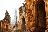 stock photo of shan  - Beautiful ancient ruins at Inn Thein Paya a large temple complex near Inle Lake in Shan State Myanmar (Burma).