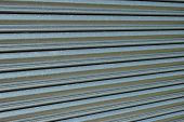 foto of roller shutter door  - Section of a steel roller shutter door on a diagonal slant - JPG
