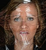Scary Image of a woman Under plastic wrap