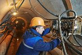 stock photo of tunnel  - Tunneller sinker worker connecting equipment in tunnel of sewer collector at undergroung working - JPG