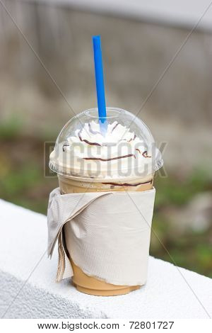 Cappuccino Frappe With Whipping Cream And Chocolate Syrup Topping.
