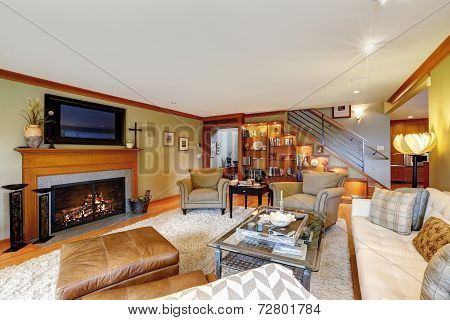 Family Room With Comfort Sitting Area And Fireplace
