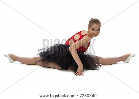 Photo of stretching ballerina