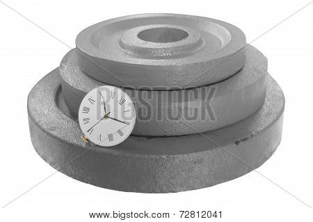 clock on stack of weight disc
