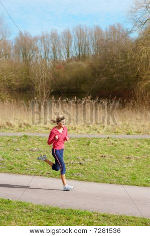 Lady Jogging In A Park