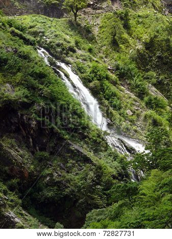 Waterfall Crosses A Trekking Trail In The Annapurna Himalayas