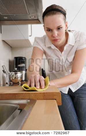 Frustrated Woman Cleaning The Kitchen