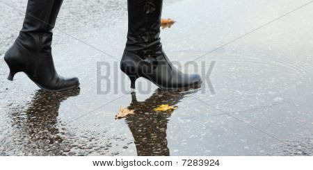 Woman stepping into a pool of water
