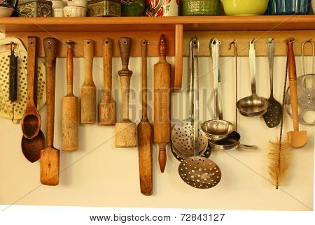 Wooden And Metal Kitchen Ware Hanging On The Wall.