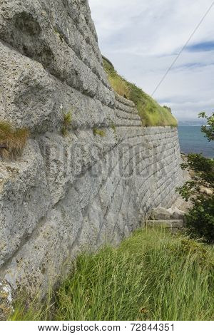 Old Stone Walls With Sea In Background. The Nothe Fort.