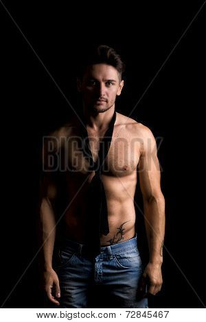 Handsome Shirtless Muscular Man Standing On Dark