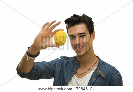 Smiling Young Man Holding A Fresh Yellow Lemonin His Hand