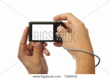 Hands With Digital Photo Camera