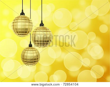 Golden Disco Balls Against Bokeh