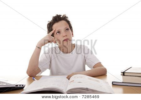 Cute Boy On The Desk Studying And Thinking