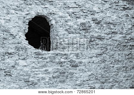 Stone Ruins Of Silvery Color With A Hole