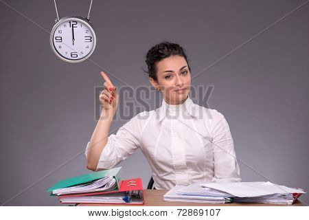 Waist-up portrait of young girl sitting at the table in office